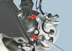 Замена суппорта тормозного механизма переднего колеса в сборе с направляющей колодок Опель Астра Н